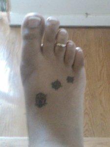 feet tat